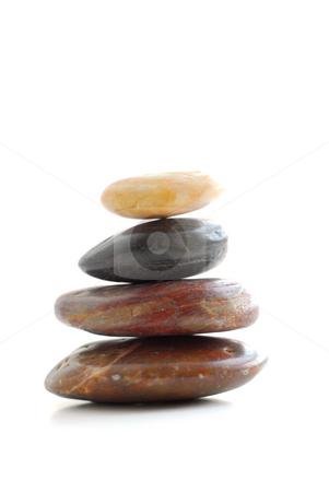 Stones stock photo, Stack of balanced stones isolated on white background by Elena Elisseeva