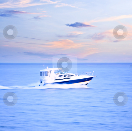 Speedboat stock photo, Speedboat at dusk, panning shot, in-camera motion blur by Elena Elisseeva
