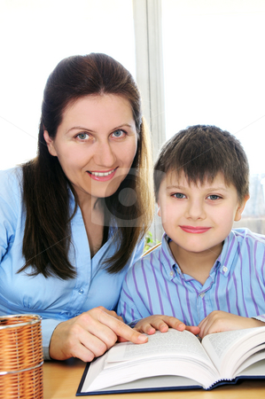 Tutoring stock photo, Teacher or tutor helping school boy to study by Elena Elisseeva