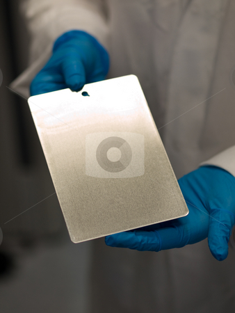 Scientist at work stock photo, Scientist at work holding a test coating plate by Laurent Dambies