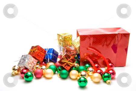Christmas Ornaments stock photo, A pile of Christmas ornaments in a gift bag. by Robert Byron