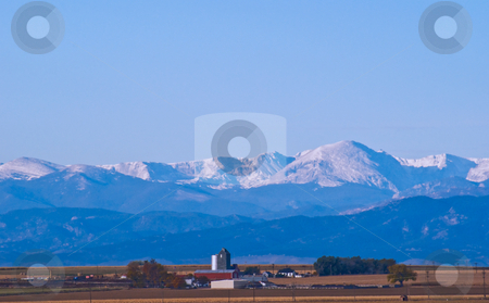 Farming under the Rocky Mountains stock photo, A peaceful farm, located just east of the Rocky Mountains. by RCarner Photography