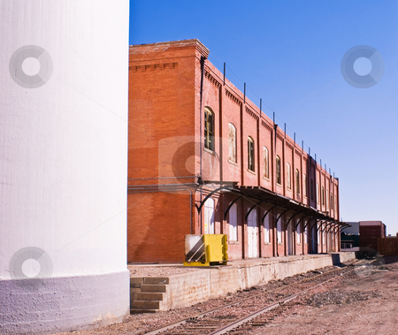 Old loading docks for railcars stock photo, Old warehouse with unused loading docks. by RCarner Photography