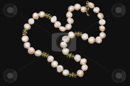 Pearls and Peridots stock photo, Necklace of pink, button pearls with faceted peridots and gold spacers and clasp on black background by Angela Arenal