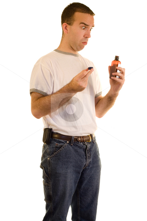 Man Taking Medicine stock photo, A sick man about to take some medicine by Richard Nelson