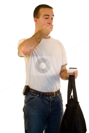 Credit Card Debt stock photo, A you man looking shocked because he is in debt by Richard Nelson