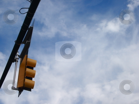 Traffic Signal against a Cloudy Sky stock photo, A traffic signal stands out against a cloudy Colorado sky. by Ben O'Neal