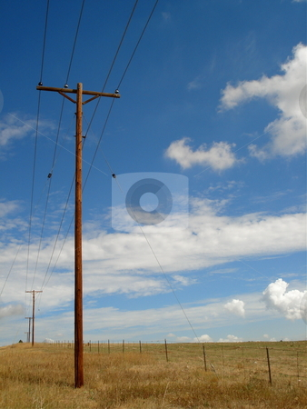 Telephone Poles stock photo, A row of telephone poles out in an empty Colorado Field. by Ben O'Neal