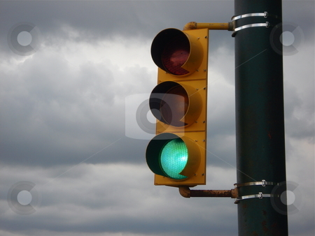 Traffic Signal with Story Sky stock photo, A traffic signal in front of a stormy Colorado sky. by Ben O'Neal