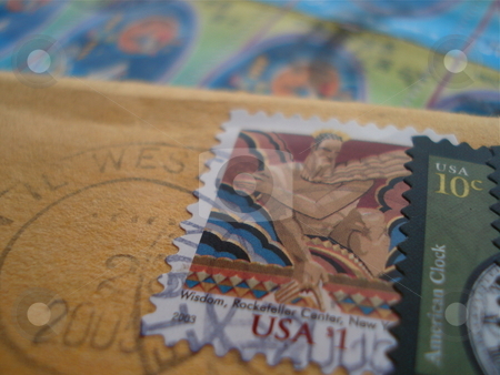 Postage Stamps stock photo, Two envelopes with an array of colorful postage stamps on them. by Ben O'Neal