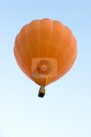 Balloon stock photo, A hot air balloon up in the air against a blue sky by Nicholas Rjabow