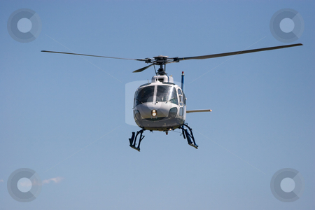 Helicopter stock photo, Helicopter in flight by Nicholas Rjabow