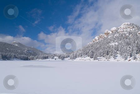 Winter Lake and Sky stock photo, Copeland Lake in winter with a fast moving sky. by John McLaird
