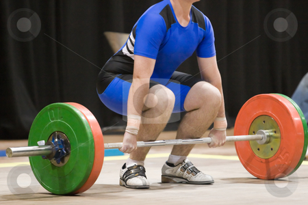 Weightlifting stock photo, A weightlifter about to lift by Nicholas Rjabow