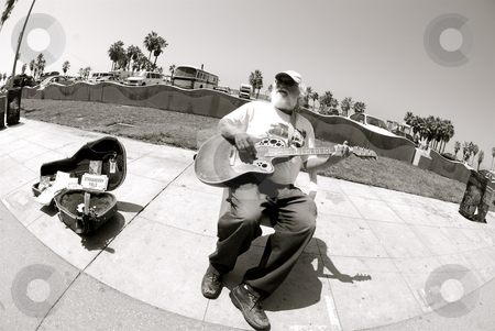 Man playing guitar stock photo, Editorial use only by Nate Hunt