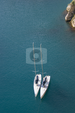 Sailboats stock photo, Aerial view of two white sailboats in a deep blue lagoon. Mediterranean sea - French Riviera. by Serge VILLA