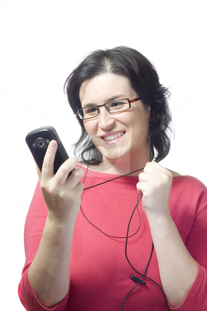 Woman technology mp3 music stock photo, Young woman listening, dancing and singing to music in a mp3 device by Ivan Montero