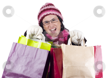 Christmas shopping woman stock photo, Consumerist Christmas girl with bags in a shopping day by Ivan Montero