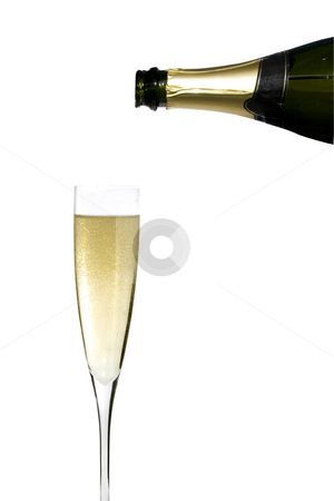 Champagne celebration stock photo, Filling a glass cup with champagne wine isolated on withe background by Ivan Montero
