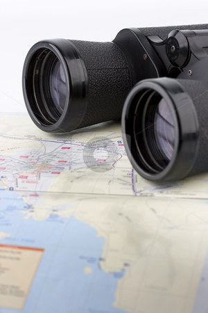 Isolated binoculars stock photo, Close up of a binoculars tool isolated over a map background by Ivan Montero
