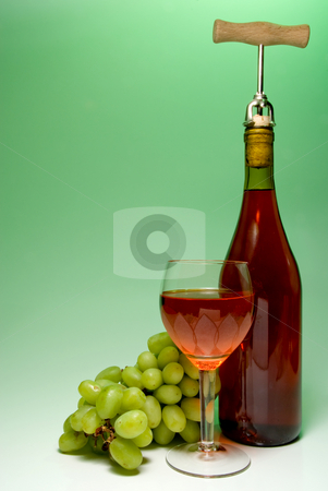 Wine stock photo, A glass of wine beside grapes and a bottle. by Robert Byron