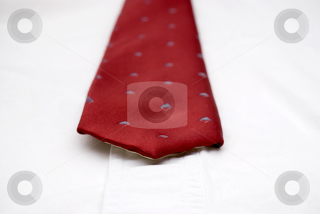 Macro of a necktie on a white shirt stock photo, Shallow focus macro of a necktie on a white shirt by Vince Clements