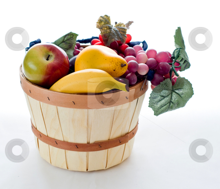 Basket of autumn fruit stock photo, A small basket filled with various fruit by RCarner Photography