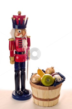 Where are the nuts stock photo, A nutcracker wonders where the nuts are in a fruit basket. by RCarner Photography