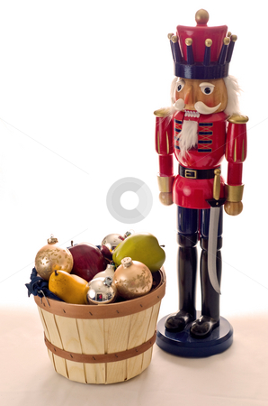 Guarding the fruit basket stock photo, A nutcracker stands over a fruit basket by RCarner Photography