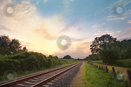 Railway tracks  stock photo, Railway tracks in a rural scene with nice pastel sunset by Karin Claus