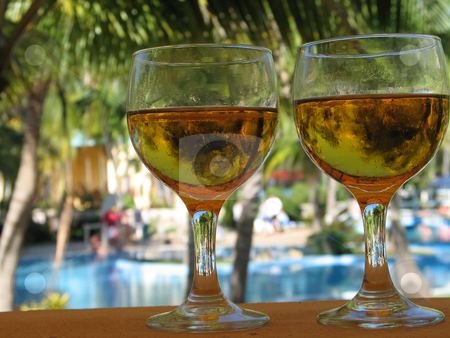Beer glasses by the pool stock photo,  by Mbudley Mbudley