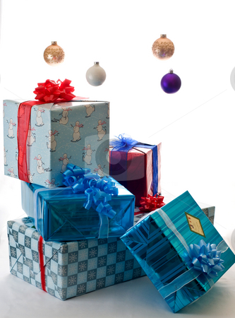 Presents waiting for Christmas morning stock photo, Stack of presents under floating Christmas ornaments by RCarner Photography