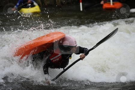 Kayaker stock photo, Whitewater kayaker doing a trick by Moriya Beck
