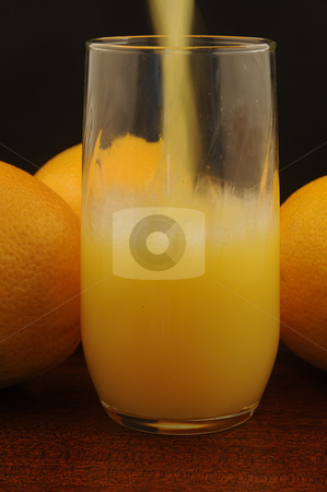 OJ in the Morning stock photo, Preparing Orange Juice in the morning. by Timothy OLeary