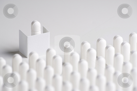 Pill Conference stock photo, A pill on a podium speaks out to lines of pills by Steve Smith
