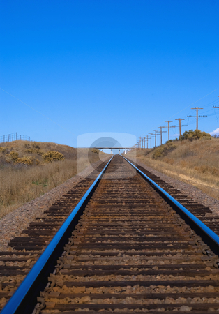 Railroad tracks across the plains stock photo, Perspective view of railroad tracks by RCarner Photography