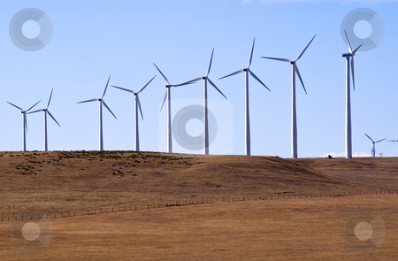 Wind generators make electricity stock photo, Making electricity the clean way. by RCarner Photography