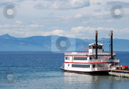 Paddle Wheel Boat on Lake stock photo, Paddle wheel boat docked on a lake by Denis Radovanovic