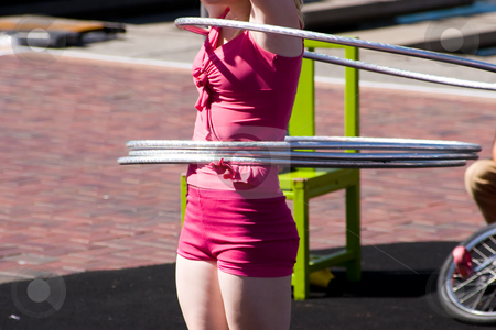 Hula Hoops stock photo, A performer twirling hula hoops by Nicholas Rjabow