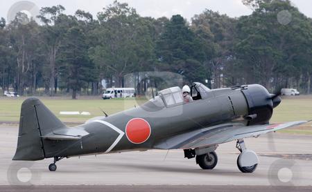 Warbird stock photo, A japanese warplane on the  runway by Nicholas Rjabow