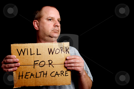 Will Work for Healthcare stock photo, A man holding a sign that implies that he will work for healthcare. by Robert Byron