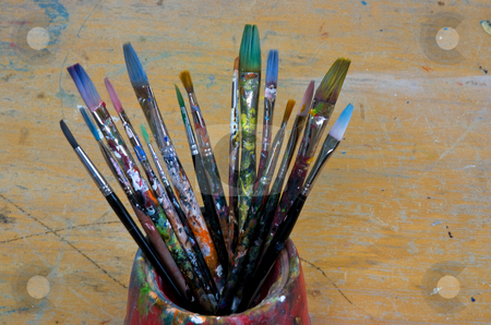 Used stock photo, Several artist brushes in a pot, all have been used many times by Paul Phillips