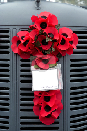 Remembrance stock photo, Poppy's in the shape of a cross fastened to the grill of a vintage truck by Paul Phillips