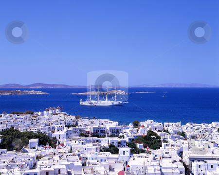 Island hopping stock photo, A large white sailing boat going into the port of Mykonos, a Greek island by Paul Phillips