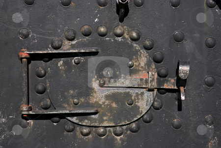 Full steam stock photo, The boilerplate of an old steam locomotive by Paul Phillips