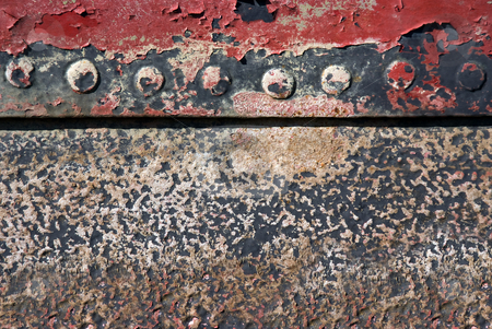 Rusted hull stock photo, The hull of an old ship rusted with age by Paul Phillips