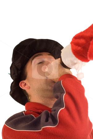 Drunk Christmas man stock photo, A man getting drunk while wearing Christmas clothes, isolated against a white background by Richard Nelson