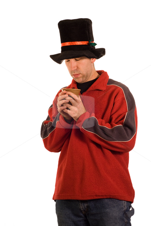 Hot Cocoa stock photo, A young man warming up with a cup of hot cocoa by Richard Nelson