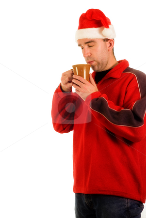 Man blowing on Hot Chocolate stock photo, A man wearing red smelling his hot cocoa by Richard Nelson