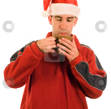 Man sipping Hot Cocoa stock photo, A man wearing red smelling his hot cocoa by Richard Nelson